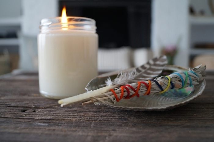 zen yoga space with candle, feather and sage -yogatoday