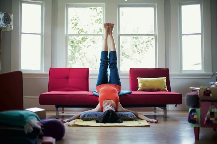 woman practices yoga at home -yogatoday